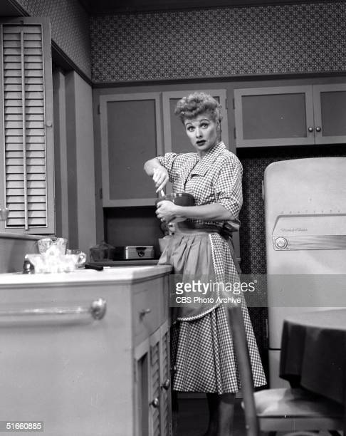 American actress Lucille Ball stirs a bowl of food in an episode of 'I Love Lucy' titled 'Nursery School' November 3 1955