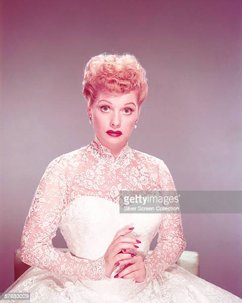 American actress Lucille Ball wearing a white lace wedding dress circa 1955