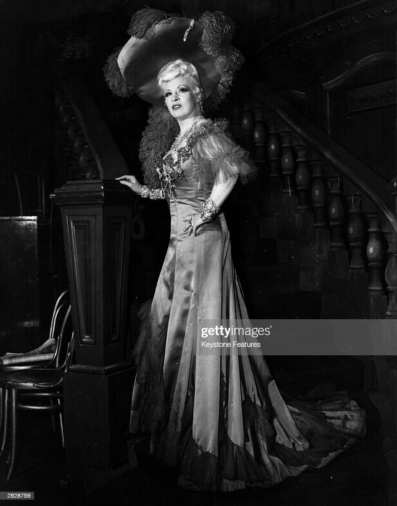 American actress <a gi-track='captionPersonalityLinkClicked' href=/galleries/search?phrase=Mae+West&family=editorial&specificpeople=69994 ng-click='$event.stopPropagation()'>Mae West</a> on stage in London.