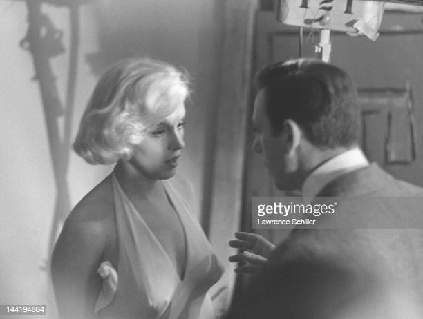 American actress Marilyn Monroe and French actor Yves Montand rehearse lines on set during the filming of their movie 'Let's Make Love' Los Angeles...