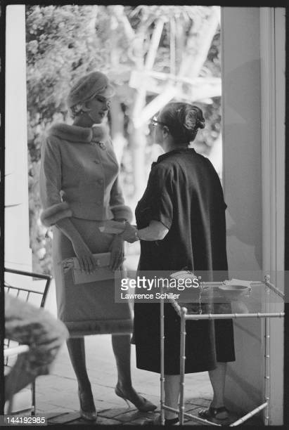 American actress Marilyn Monroe and her dialogue coach Paula Strasberg discuss a scene on set during the filming of 'Something's Got to Give' Los...
