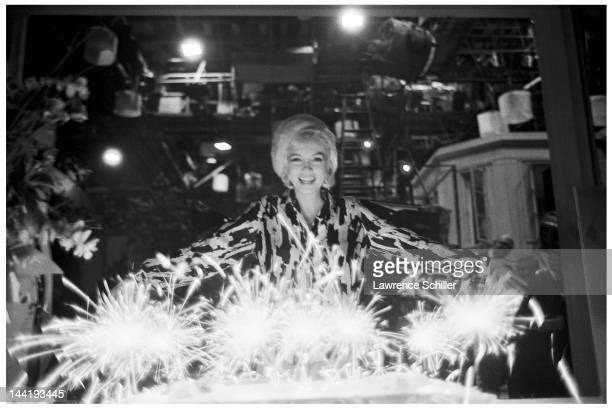 American actress Marilyn Monroe celebrates her birthday with cake and sparklers during the filming of 'Something's Got to Give' Los Angeles...