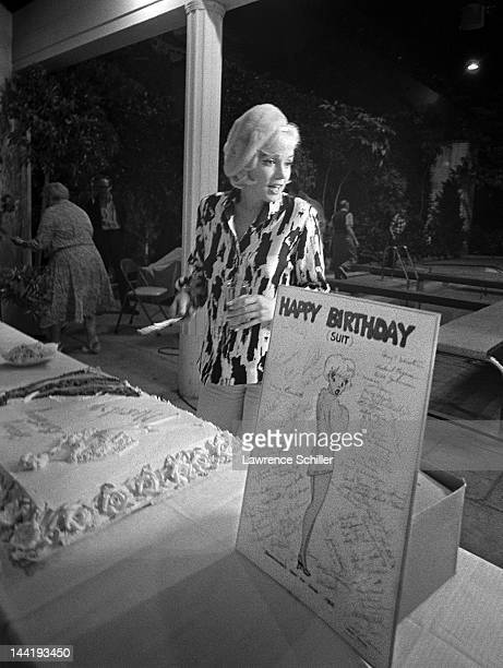 American actress Marilyn Monroe cuts her birthday cake during the filming of 'Something's Got to Give' Los Angeles California June 1 1962 This was...