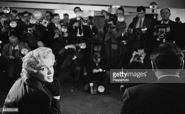 American actress Marilyn Monroe holds a press reception at the Savoy Hotel in London 1956