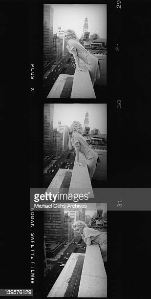 American actress Marilyn Monroe leans over the balcony of the Ambassador Hotel in New York City March 1955