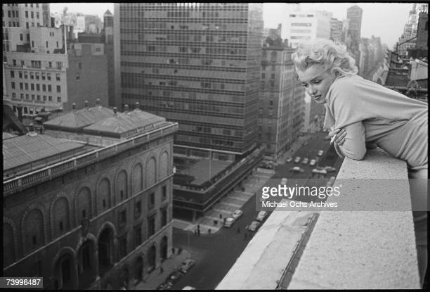 American actress Marilyn Monroe leans over the balcony of the Ambassador Hotel in March 1955 in New York City New York