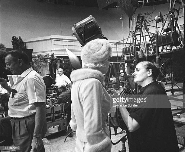 American actress Marilyn Monroe listens to her dialogue coach Paula Strasberg on set during the filming of 'Something's Got to Give' Los Angeles...