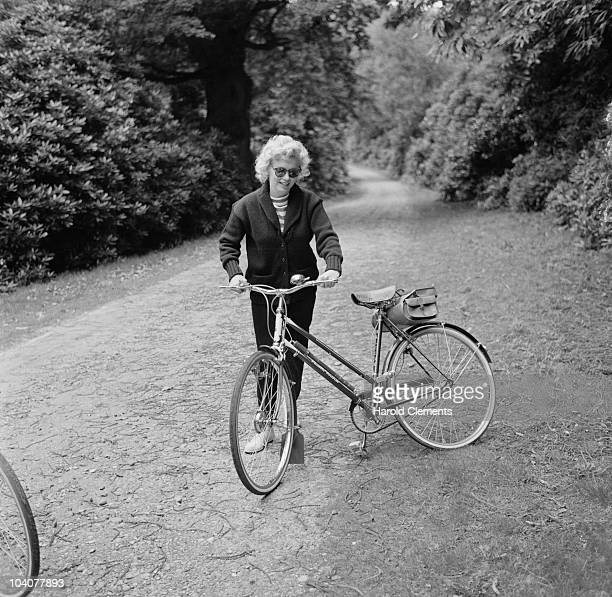American actress Marilyn Monroe out for a cycle ride UK 13th August 1956