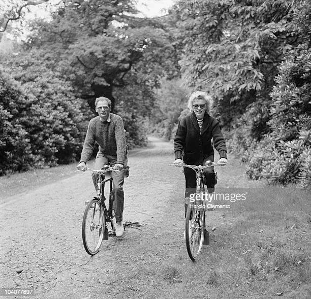 American actress Marilyn Monroe out for a cycle ride with her third husband American dramatist Arthur Miller 13th August 1956