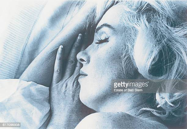 American actress Marilyn Monroe photographed apparently asleep in Beverly Hills California at the end of June 1962 The two sessions for the...