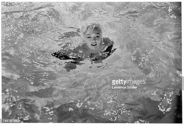 American actress Marilyn Monroe swims in a pool for a scene during the filming of 'Something's Got to Give' Los Angeles California May 23 1962
