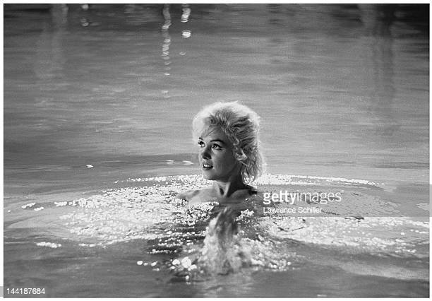 APPLY American actress Marilyn Monroe swims in a pool for a scene during the filming of 'Something's Got to Give' Los Angeles California May 23 1962