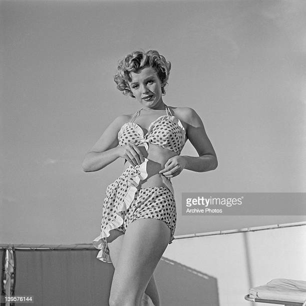 American actress Marilyn Monroe wearing a polka dot bikini with a matching wraparound miniskirt circa 1951