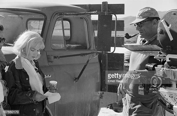 American actress Marilyn Monroe with her husband playwright Arthur Miller during the location shoot of 'The Misfits' in the Nevada Desert 1960