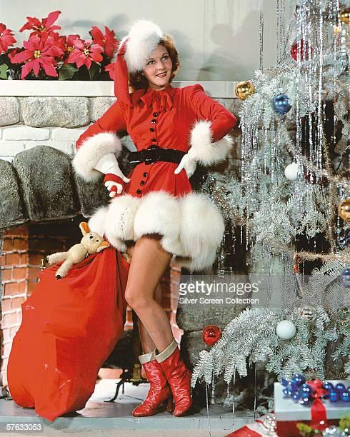 American actress Mary Martin dressed as a saucy Santa Claus circa 1940