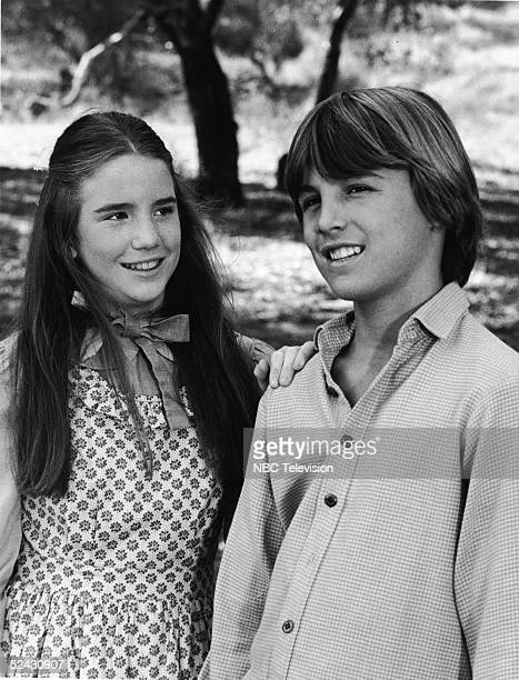 American actress Melissa Gilbert places her hand on the shoulder of American actor Chris Petersen in a scene from the episode of the television...