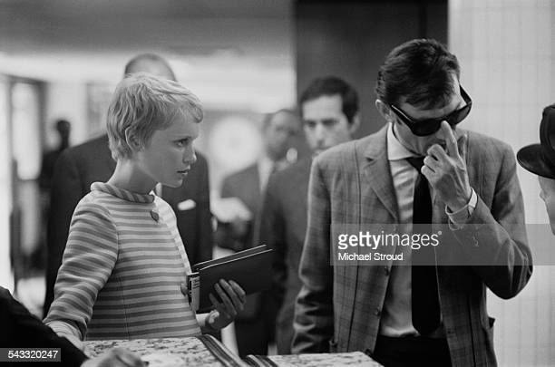 American actress Mia Farrow and Lithuanianborn actor Laurence Harvey at London Airport 1967