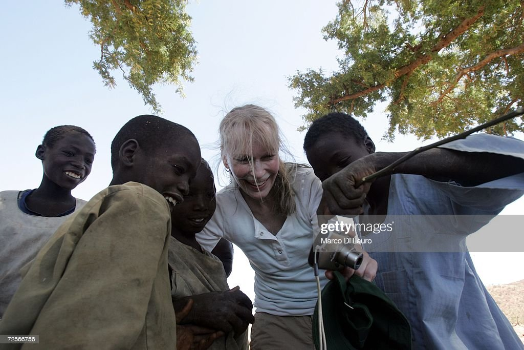 American actress Mia Farrow (C) talks to Chadian internally displaced people (IDP) on November 15, 2006, in Goz Beida, Chad. Farrow, toured Eastern Chad for three days as a United Nations good will ambassador of the Save Darfur Coalition and UNHCR (United Nations High Commission for Refugees) to learn more about the current situation and the latest violence that has spread in Eastern Chad from Darfur. Farrow plans to tell the stories of the people suffering to the world to demand to stop the violence.