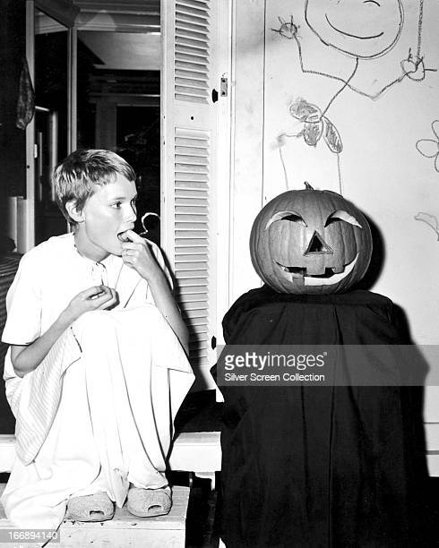 American actress Mia Farrow with a Halloween pumpkin circa 1970