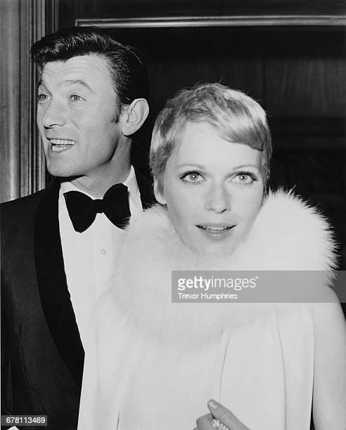 American actress Mia Farrow with actor Laurence Harvey at the premiere of the James Bond film 'Casino Royale' at the Odeon Leicester Square London...