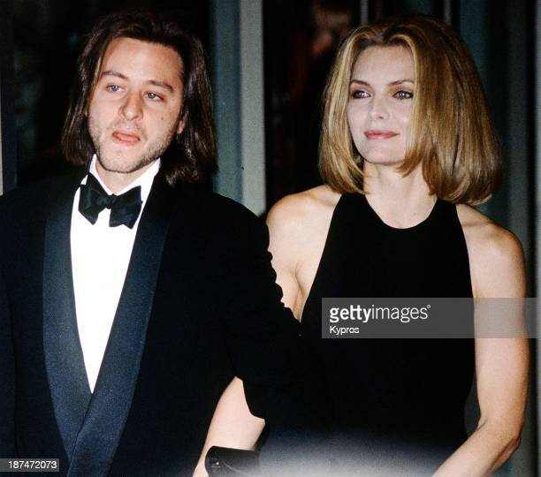 American actress Michelle Pfeiffer with actor Fisher Stevens circa 1990