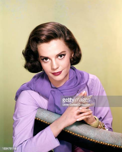 American actress Natalie Wood in a lilac top and scarf circa 1960