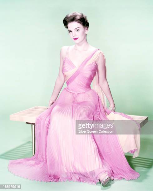 American actress Natalie Wood wearing a ruched pink evening dress circa 1960