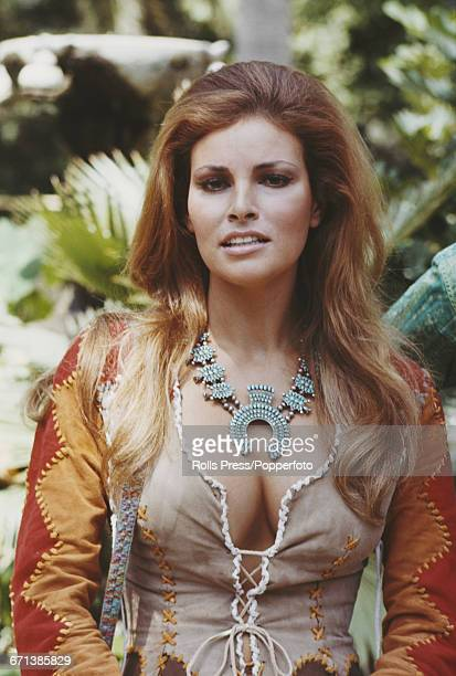 American actress Raquel Welch posed wearing a multicoloured suede patchwork bodice and jacket and necklace in Rome Italy prior to the start of...