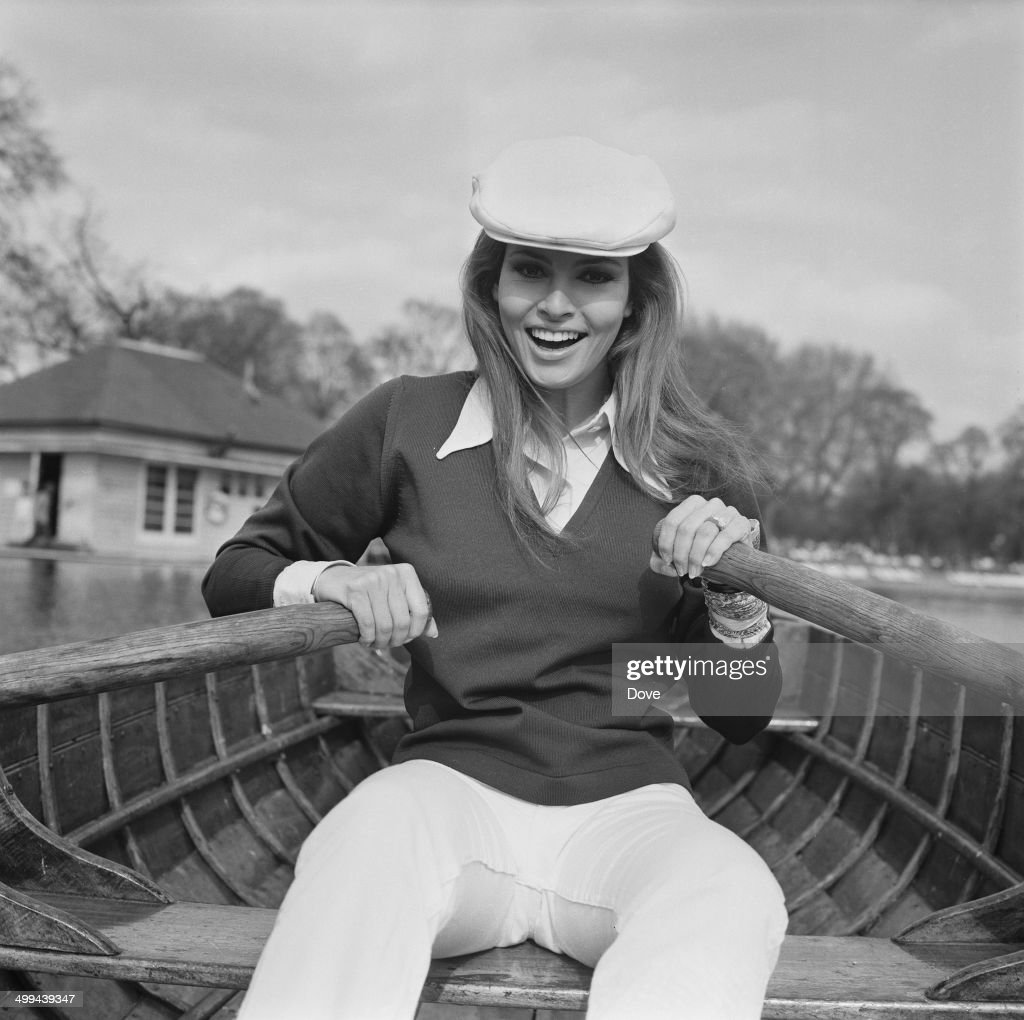 American actress <a gi-track='captionPersonalityLinkClicked' href=/galleries/search?phrase=Raquel+Welch&family=editorial&specificpeople=203311 ng-click='$event.stopPropagation()'>Raquel Welch</a> rowing on the Serpentine, London, 18th April 1969.