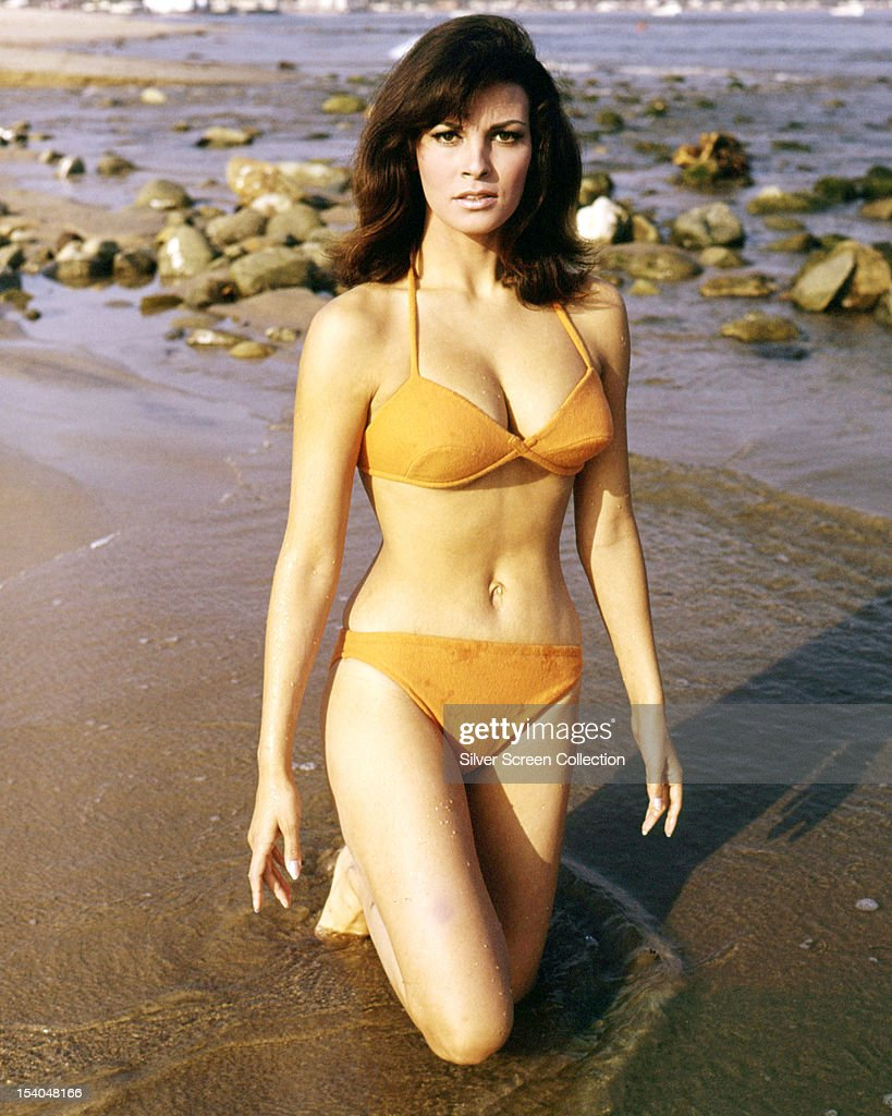American actress <a gi-track='captionPersonalityLinkClicked' href=/galleries/search?phrase=Raquel+Welch&family=editorial&specificpeople=203311 ng-click='$event.stopPropagation()'>Raquel Welch</a> wearing an orange bikini in a publicity still for 'The Biggest Bundle of Them All', directed by Ken Annakin, 1968.