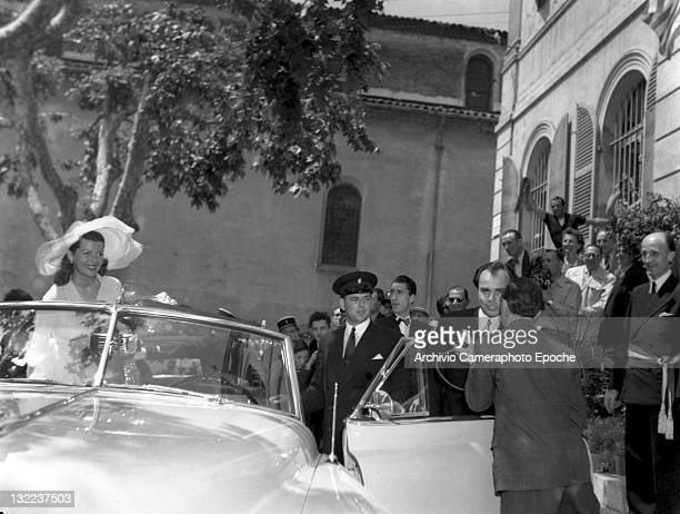 American actress Rita Hayworth and Ali Khan getting on the car after their wedding Vallarius 1949
