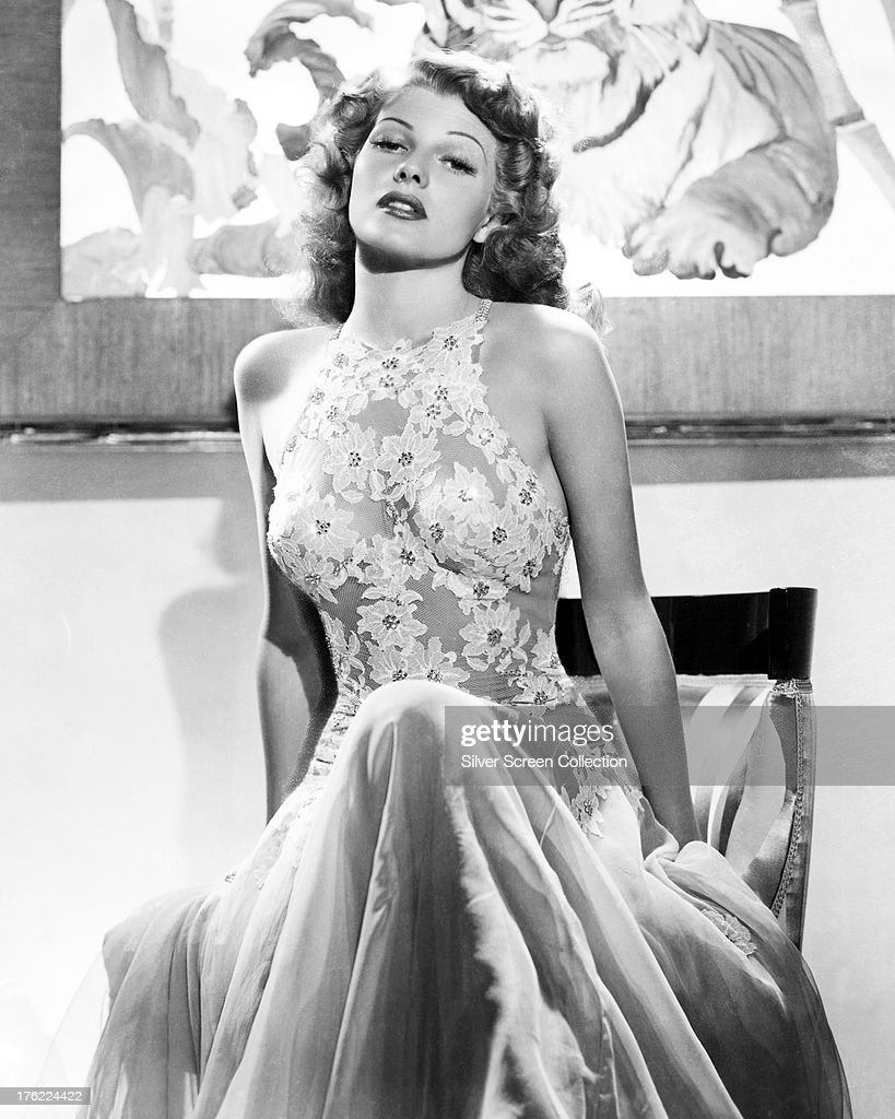 American actress <a gi-track='captionPersonalityLinkClicked' href=/galleries/search?phrase=Rita+Hayworth&family=editorial&specificpeople=70013 ng-click='$event.stopPropagation()'>Rita Hayworth</a> (1918 - 1987) in a halter-necked lace dress, circa 1940.