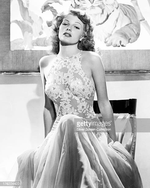 American actress Rita Hayworth in a halternecked lace dress circa 1940
