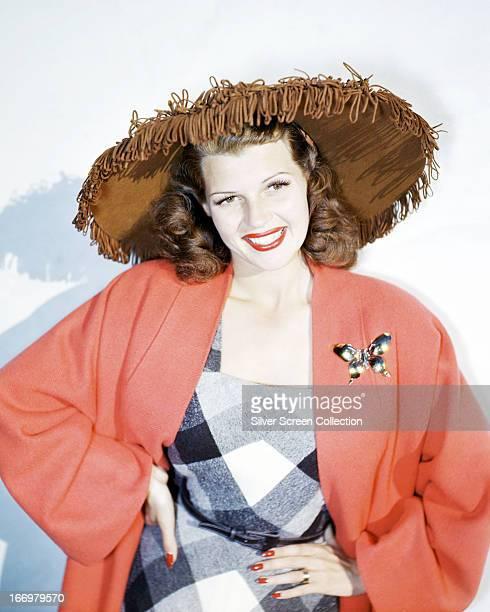 American actress Rita Hayworth in a widebrimmed sunhat circa 1945