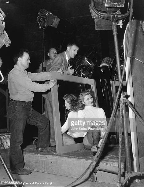 American actress Rita Hayworth on the set of the film 'Cover Girl' 1944