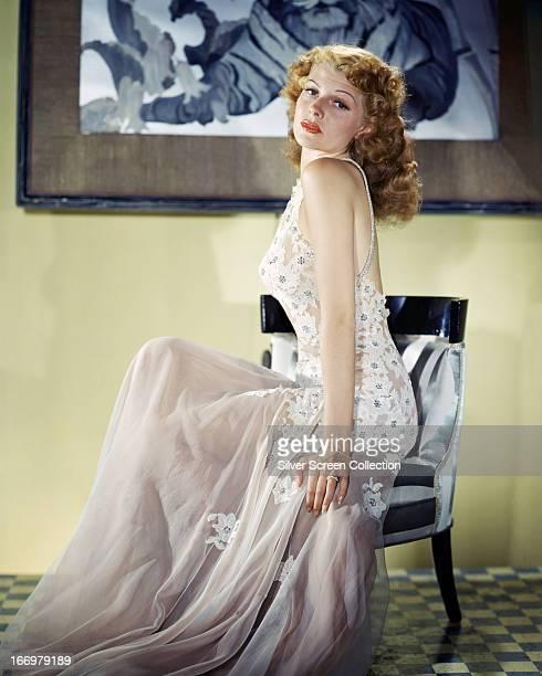 American actress Rita Hayworth wearing a diaphanous white lacy dress circa 1945