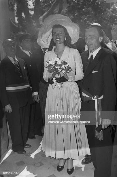 American actress Rita Hayworth with the mayor after her wedding Vallarius 1949