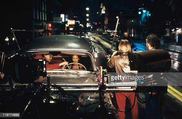 American actress Robin Givens preparing to film a driving sequence with members of the crew on 'A Rage in Harlem' directed by Bill Duke 1991
