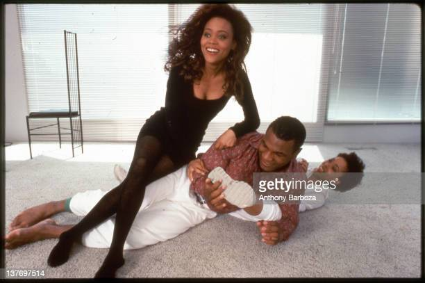 American actress Robin Givens sits on her hasband heavyweight boxer Mike Tyson who play wrestles with his mother Ruth in their new home Los Angeles...