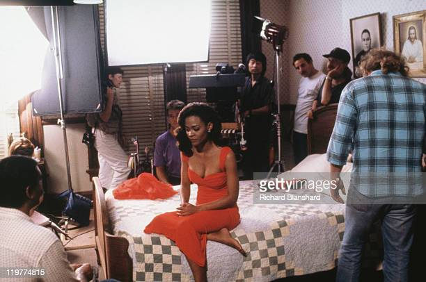 American actress Robin Givens with members of the film crew on the set of 'A Rage in Harlem' directed by Bill Duke 1991