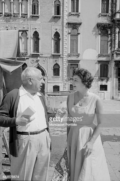 American actress Ruth Roman talking to Italian painter Giorgio de Chirico during the XVIII Venice International Film Festival Venice 1957