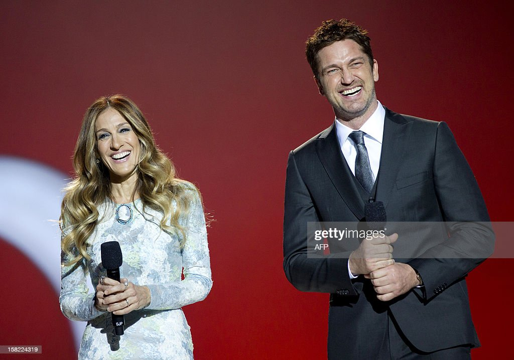 American actress Sarah Jessica Parker (L) and Scottish actor Gerard Butler host the Nobel Peace Prize concert in Oslo, Norway on December 11, 2012. Artists from all over the world gathered at the Oslo Spektrum to help spread the message of peace and celebrate this year's Nobel Peace Prize laureates, European Union (EU) President Herman Van Rompuy, President of the European Commission Jose Manuel Barroso and President of the European Parliament Martin Schulz.
