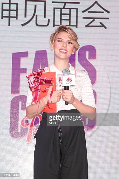 American actress Scarlett Johansson attends a fan club party of telecommunications equipment manufacturer 'Huawei' on November 10 2016 in Shenzhen...