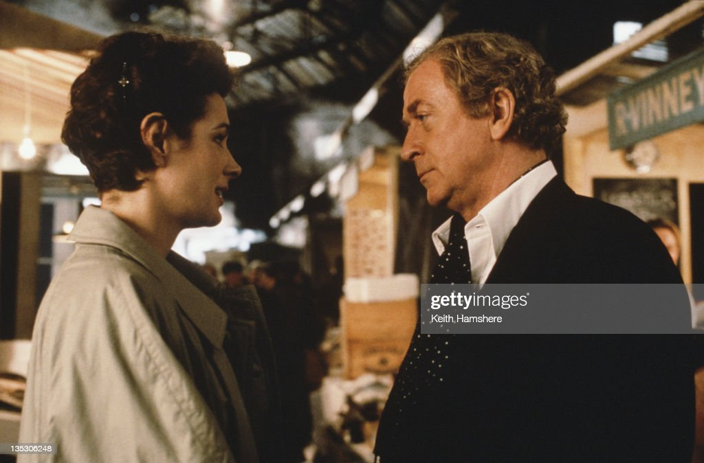 American actress Sean Young as Stacy Mansdorf and British actor <a gi-track='captionPersonalityLinkClicked' href=/galleries/search?phrase=Michael+Caine+-+Actor&family=editorial&specificpeople=159746 ng-click='$event.stopPropagation()'>Michael Caine</a> as former secret agent Harry Anders in the film 'Blue Ice', filmed on location in London, 1992.