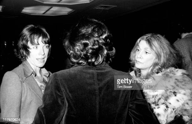 American actress Shirley MacLaine and actress and socialite Sylvia Miles speak to an unidentified person at the premiere of 'Shampoo' at the Columbia...