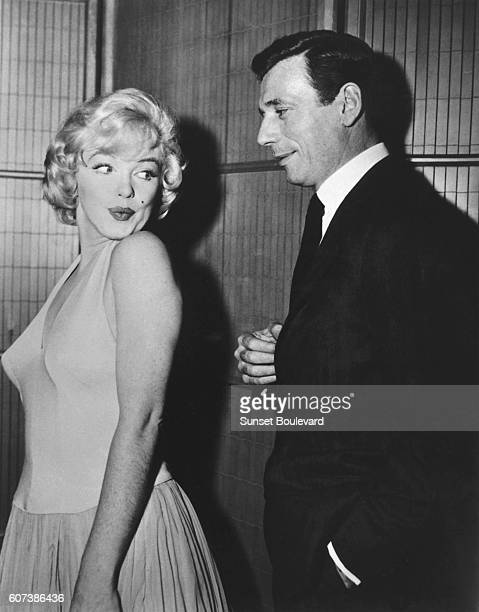 American actress singer model and sex symbol Marilyn Monroe and Italianborn French actor and singer Yves Montand on the set of Let's Make Love...