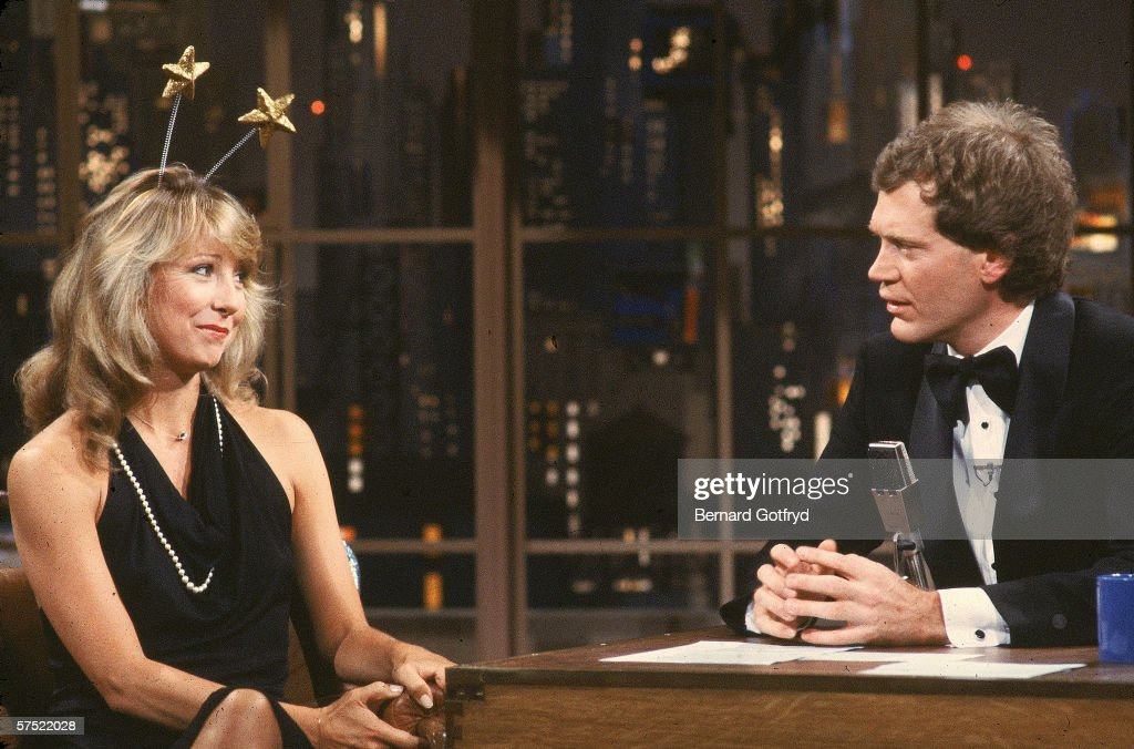 American actress Teri Garr sits and talks with tuxedo-clad talk show host <a gi-track='captionPersonalityLinkClicked' href=/galleries/search?phrase=David+Letterman+-+Televisiepresentator&family=editorial&specificpeople=171322 ng-click='$event.stopPropagation()'>David Letterman</a> as she wears a formal gown and deely-boppers during an appearance on 'Late night with <a gi-track='captionPersonalityLinkClicked' href=/galleries/search?phrase=David+Letterman+-+Televisiepresentator&family=editorial&specificpeople=171322 ng-click='$event.stopPropagation()'>David Letterman</a>,' New York, early 1980s. Garr has been a recurring guest on Letterman's programs for many years. This visit occurred between the February 1982 premiere and the replacement of the original desk and set in June 1985.