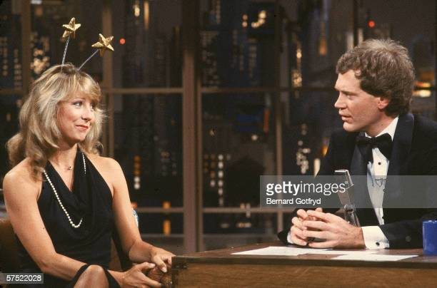 American actress Teri Garr sits and talks with tuxedoclad talk show host David Letterman as she wears a formal gown and deelyboppers during an...