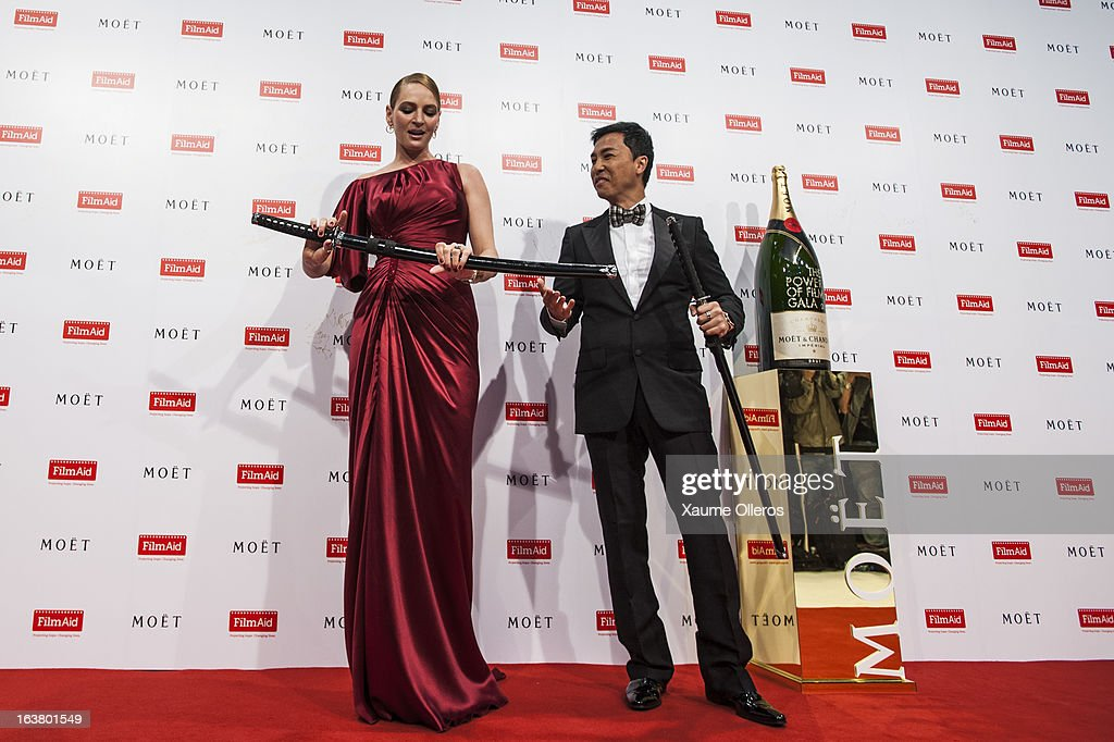American actress <a gi-track='captionPersonalityLinkClicked' href=/galleries/search?phrase=Uma+Thurman&family=editorial&specificpeople=171973 ng-click='$event.stopPropagation()'>Uma Thurman</a> (L) and Hong Kong actor Donnie Yin attend at the Moet & Chandon and FilmAid Asia Power of Film Gala at Clear Water Bay Film Studios on March 16, 2013 in Hong Kong, Hong Kong.