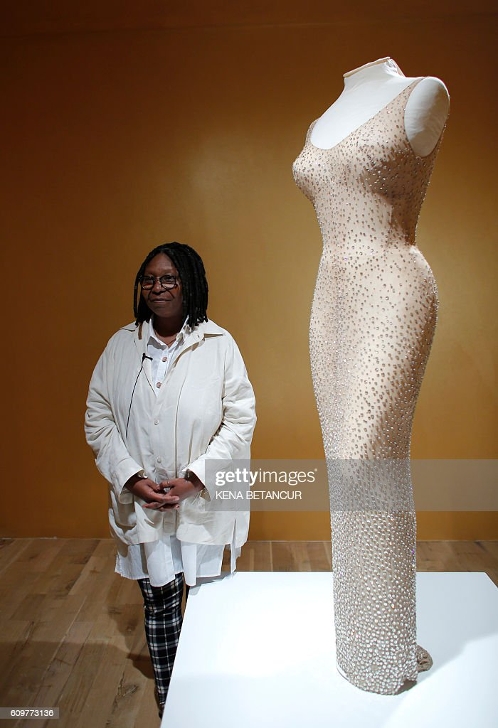 American actress Whoopi Goldberg poses next to the Marilyn Monroe iconic Happy Birthday Mr. President dress during a press preview MANA Contemporary art center in Jersey City on September 22, 2016. / AFP / KENA